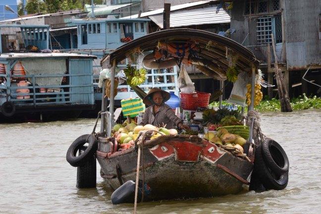 Fruit seller on the Mekong Delta
