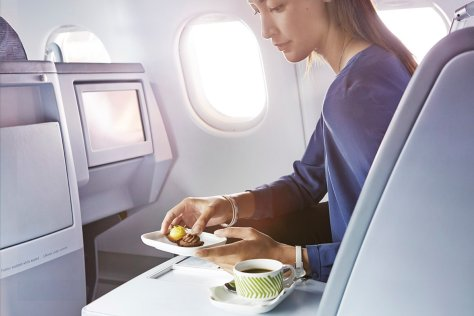 Finnair business woman having a dessert 01 Low
