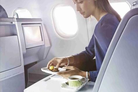 Finnair business woman having a dessert 01 Low
