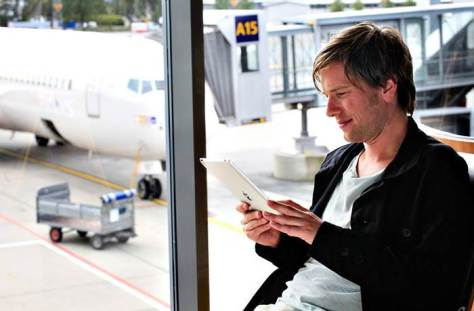 Man Using Free Wi-Fi at Oslo Airport/Avinor