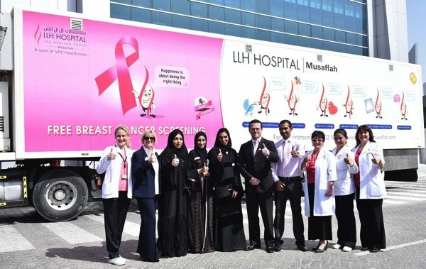 Dr Nadia Bastaki VP Medical Services and Patrick Gargan Head of Medical and Employee Wellbeing Services with the mobile breast cancer mammography screening unit
