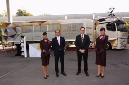 Gianni Tronza (centre left) and Peter Baumgartner (centre right) outside the Etihad Airways mobile exhibition vehicle/Etihad Airways