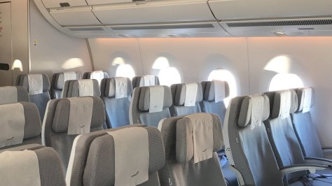 Natural light from the A350's large windows and programmable mood decorate the understated Finnair Economy cabin./FCMedia