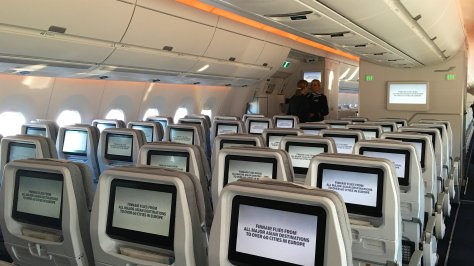 Finnair A350 Economy cabin, view of IFE and warm Asia themed mood lighting program/FCMedia