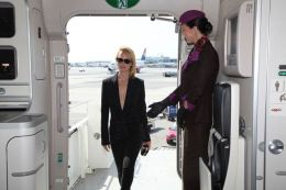 """Supermodel Amber Valletta welcomed by Etihad Airways cabin crew onboard the airline's """"NYFW: The Shows""""-branded aircraft livery."""