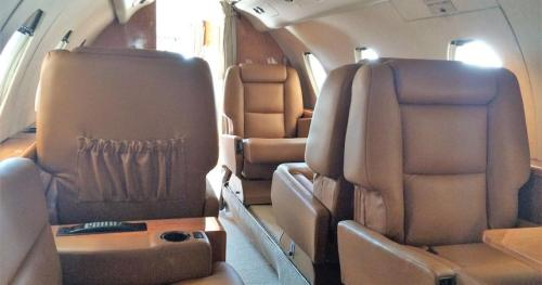 Falcon 20 passenger cabin seating 9, available for charter from Rennia Aviation in Gainesville, FL