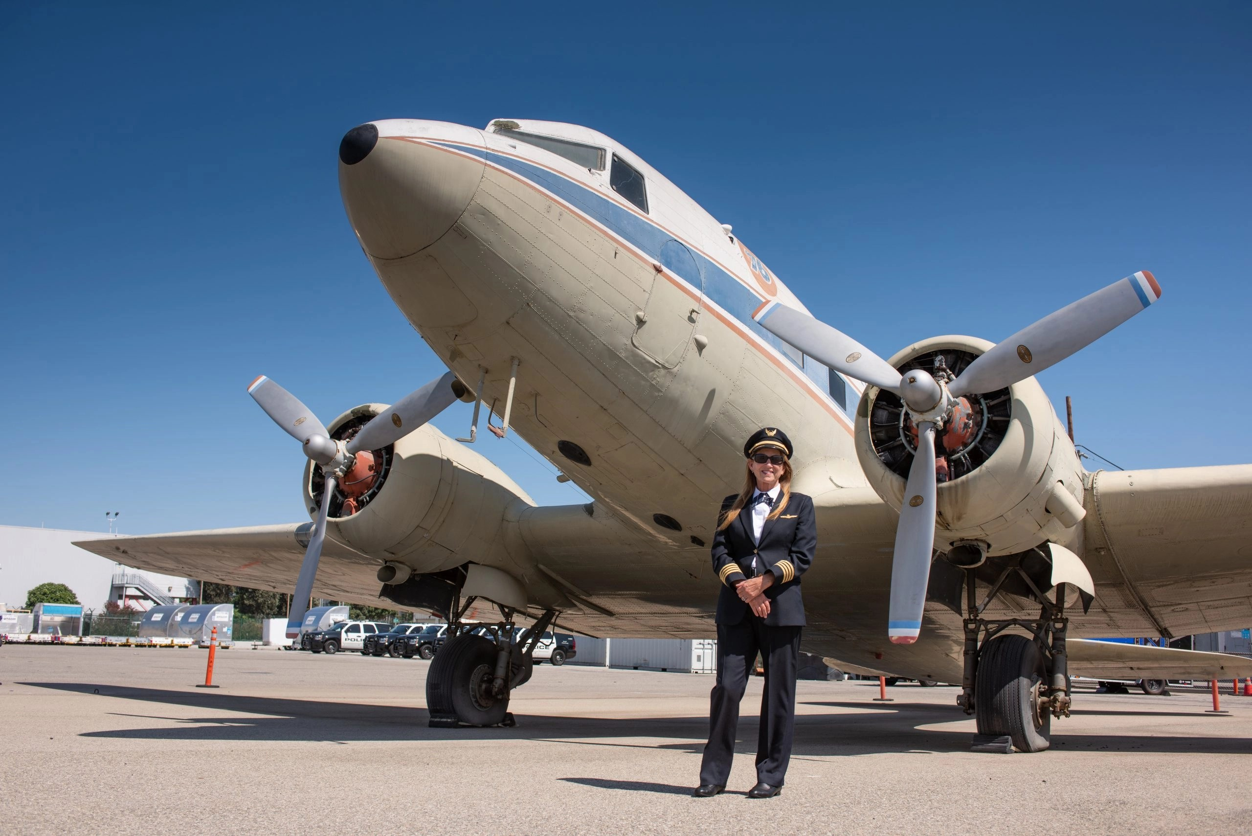 Linda Wright in front of The Spirit of 76 DC-3 at the Flight Path Museum