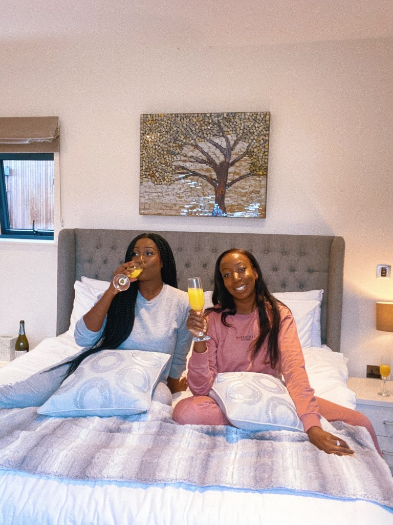 Lulu and Abi drinking mimosas on a UK staycation - travel and cocktails