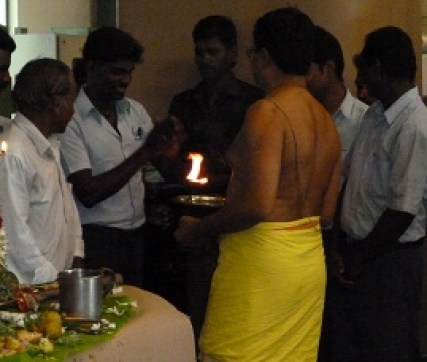 Celebrating Pooja with the locals flame