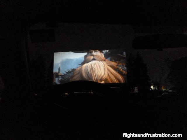 Watching a film from a car at a drive in cinema