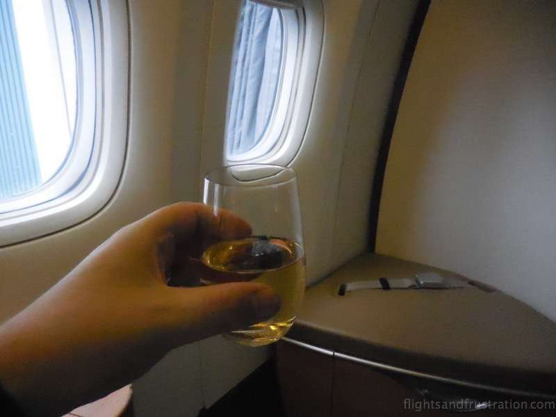Cheers with a glass of Bollinger no less air france first class review