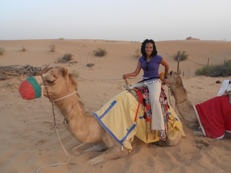 Priscilla Smiley on a camel after applying cheap travel tips