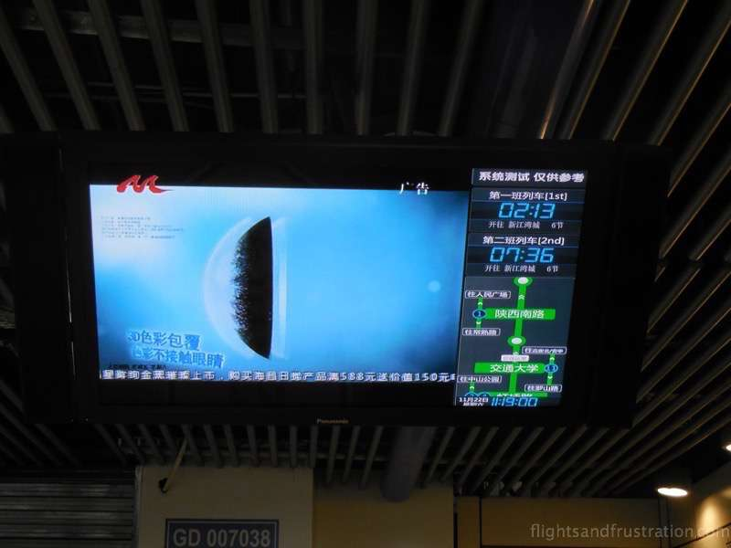Platform monitors with a countdown until when the next train arrives Shanghai Metro card