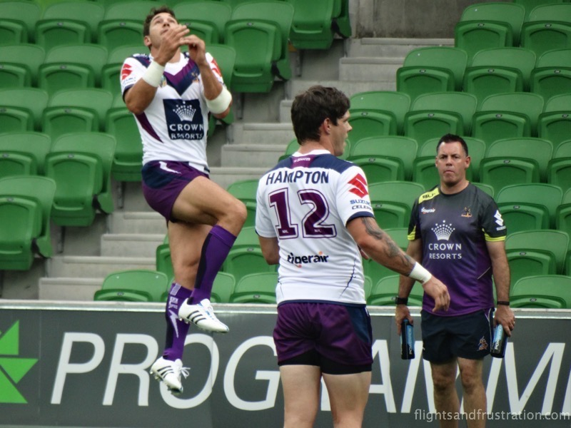Billy Slater jumping for a high ball during the warm up at the melbourne storm family fun day