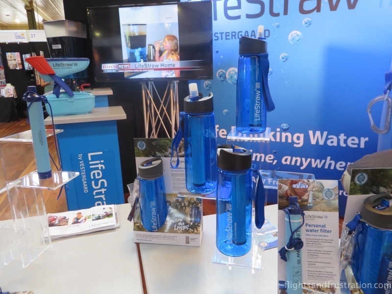 Lifestraw on the left and a range of the Lifestraw Go water bottles