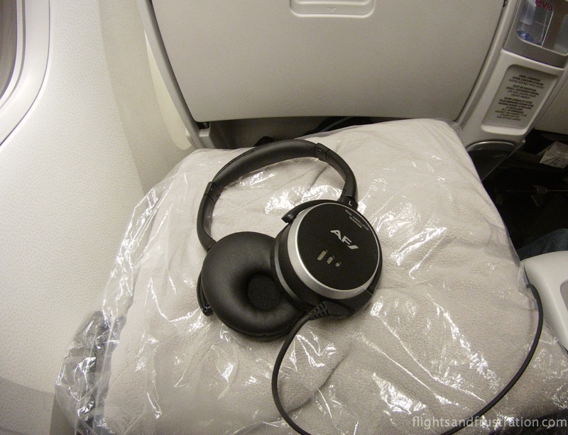 Noise reducing headphones with the Air France AF logo in air france premium economy reviews