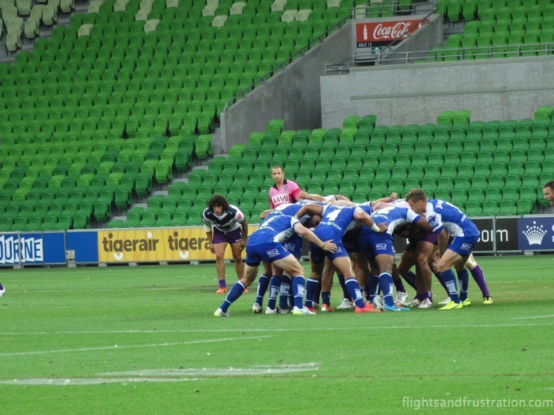 The NRL players form a scrum