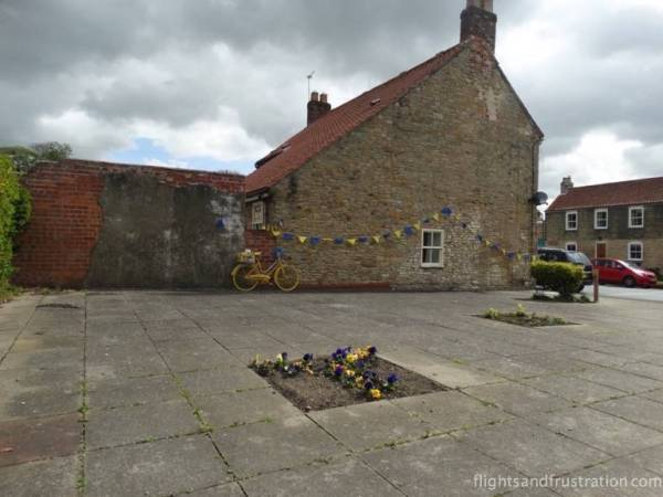 Bike in a square with bunting in North Newbald East Yorkshire