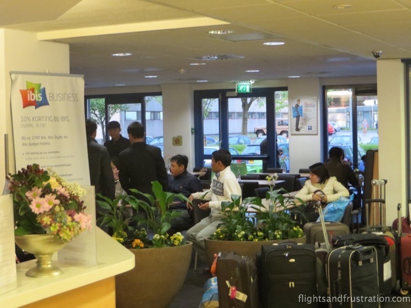 A busy reception area at the Ibis Budget Hotel Amsterdam Airport