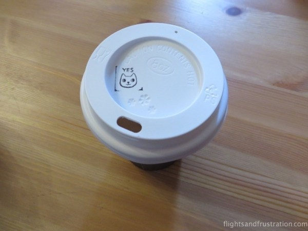 My Cat Cafe coffee with a cat smiley face