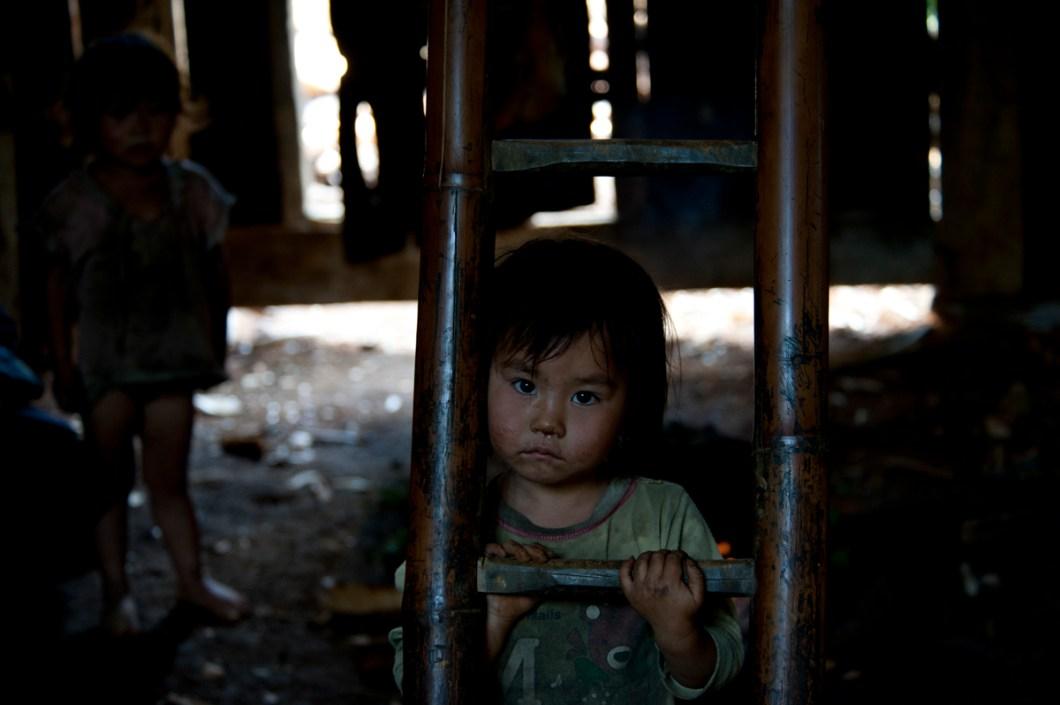 Sapa Hmong girl in ladder