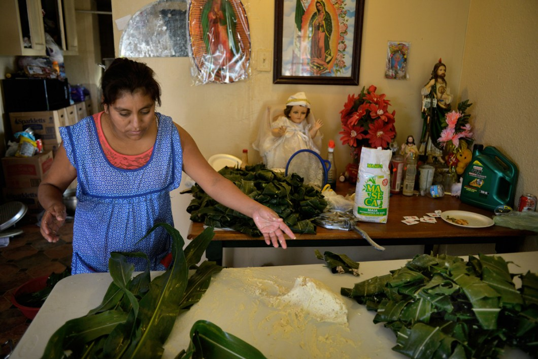 Residents in East Porterville they try to have a normal life. Josefina preparing Tamales.