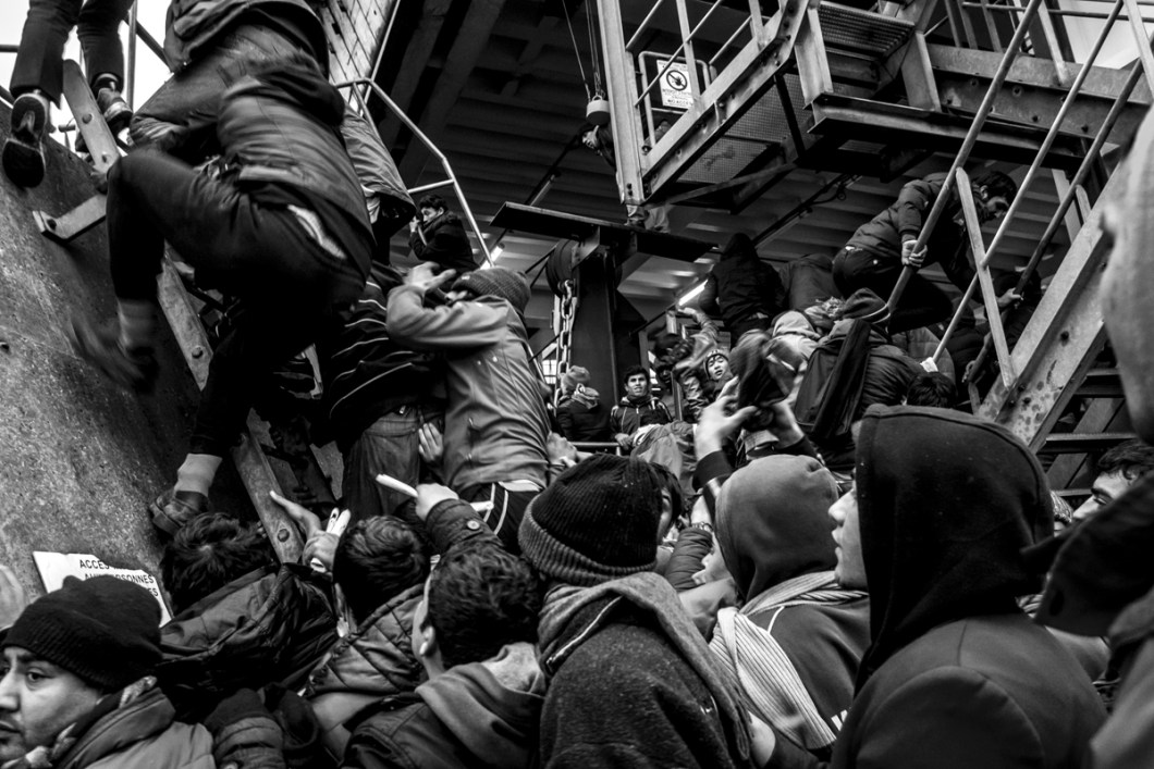 "January, 23, 2016 : Tens of refugees trying to board on a ferry docking called ""Spirit of Britain"". Calais, (62), France."