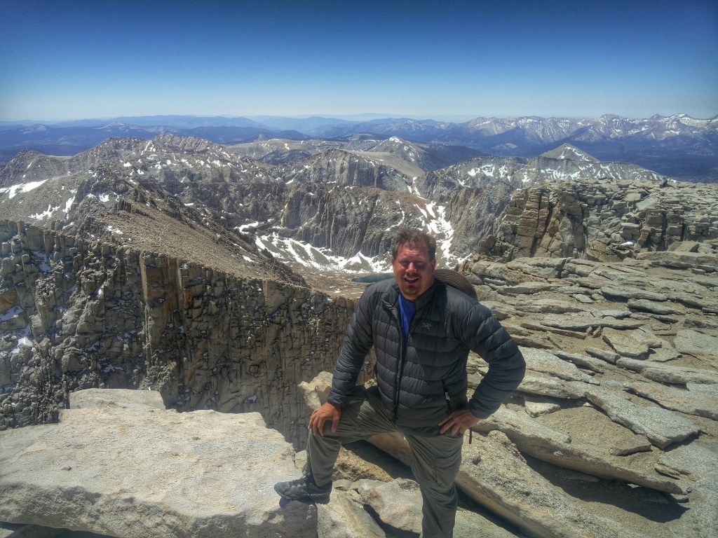 Greg Berndt from Flip Flop Wanderer standing on top of Mt. Whitney. This image is on his About Page.