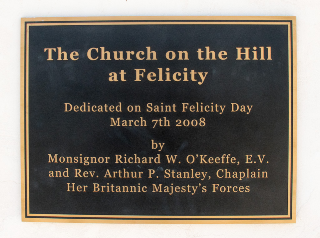 The Sign from Church on the top of the hill at Center of the world.