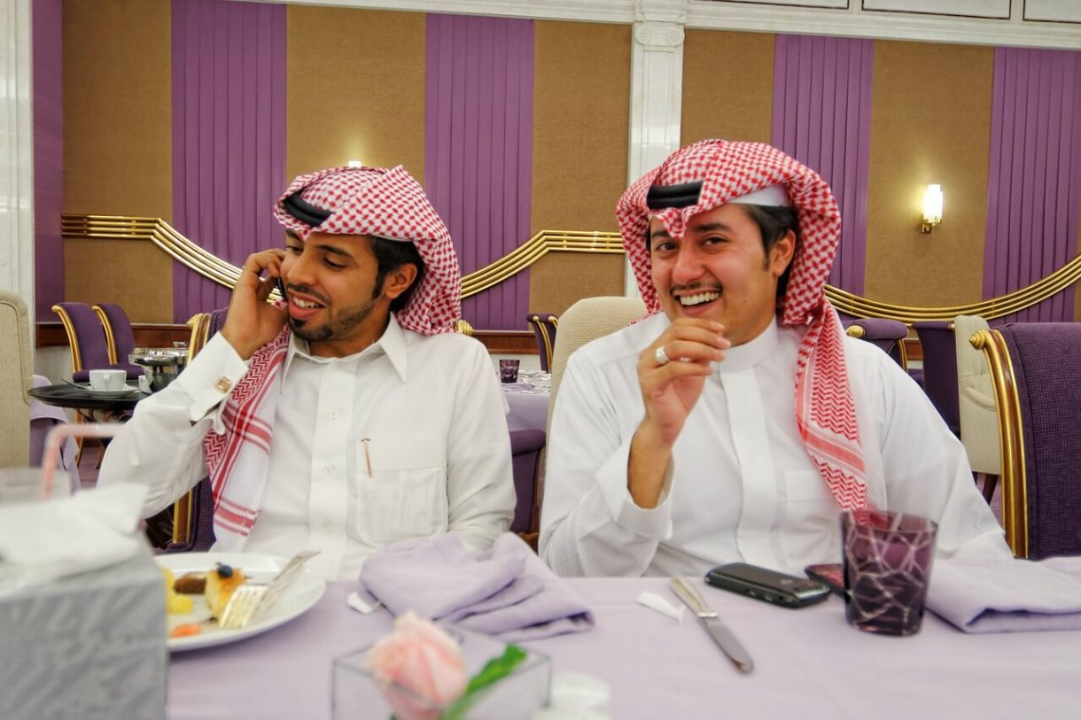 Two Arab men enjoying lunch