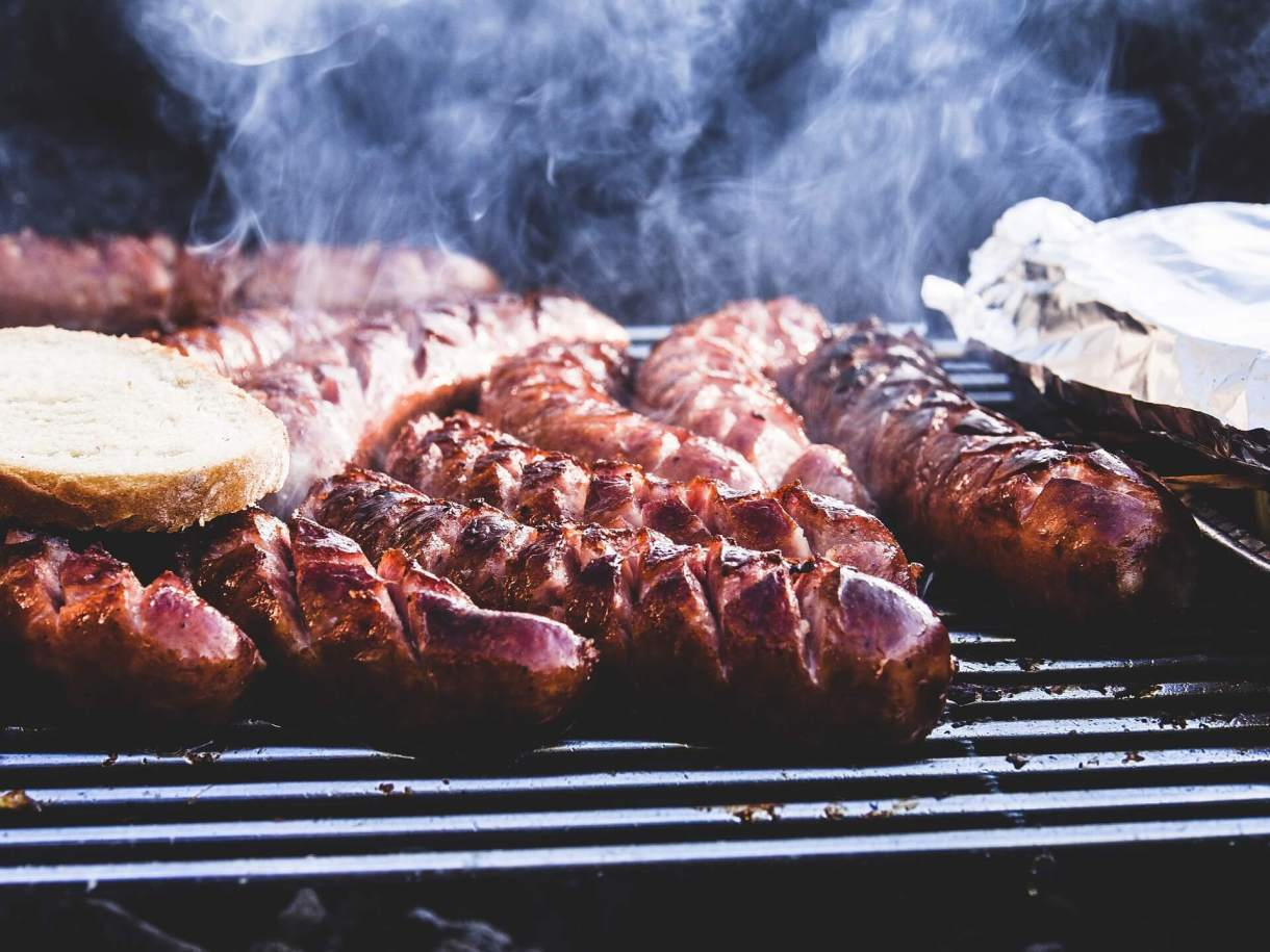 Grilling sausages perfectly on a barbecue is one of the 6 things to learn after moving to Alabama