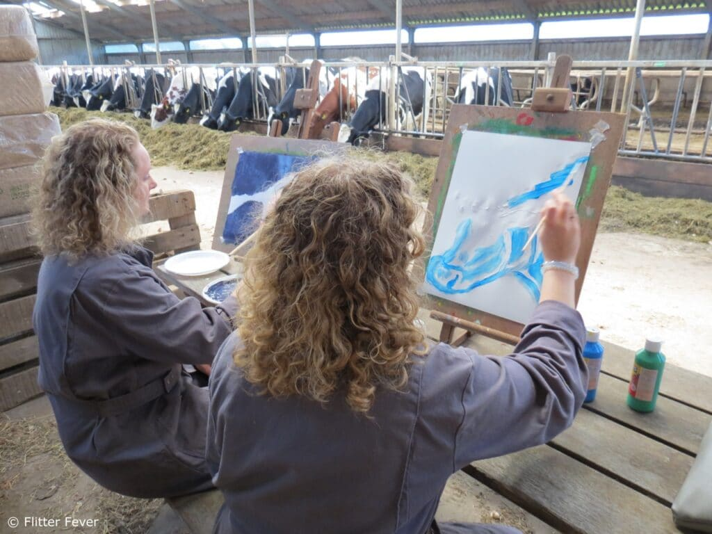 Sisters painting in the cow barn