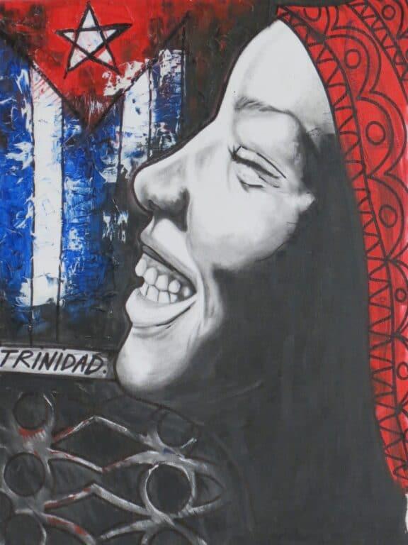 Trinidad art woman laughing & Cuban flag