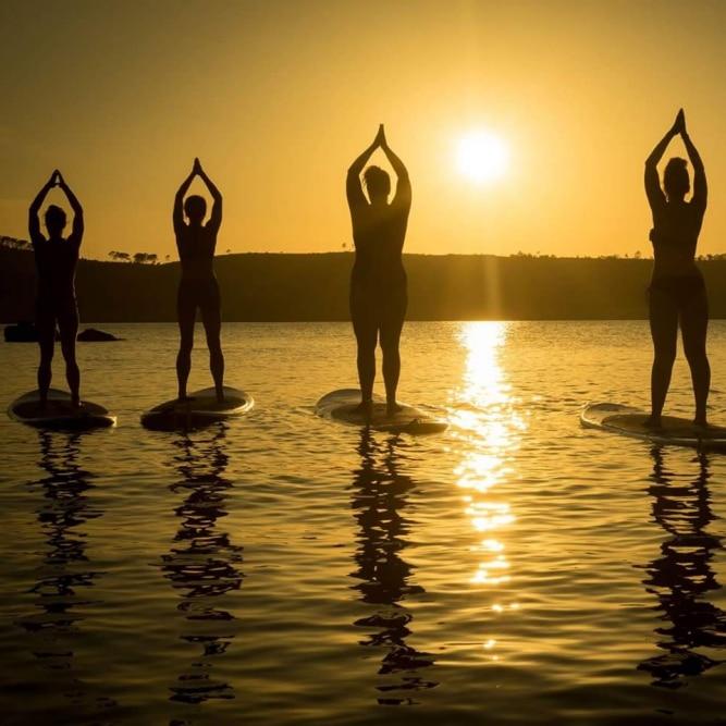 SUP yoga at sunrise