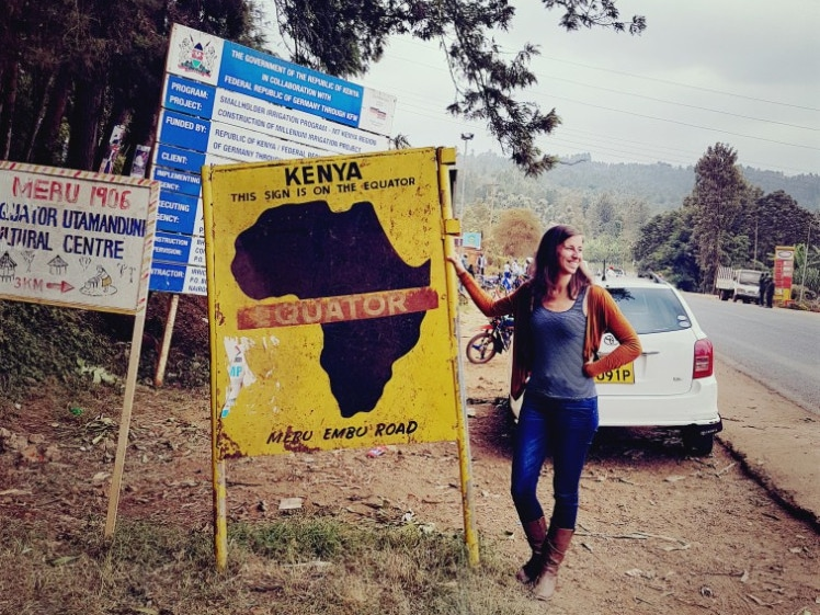 Linda at the equator in Kenya during a work trip