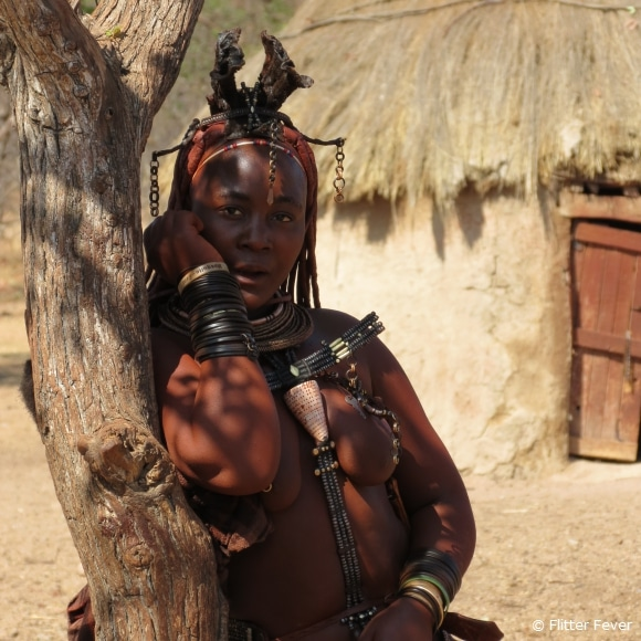 Himba woman in traditional clothing and hair style @ Namibia