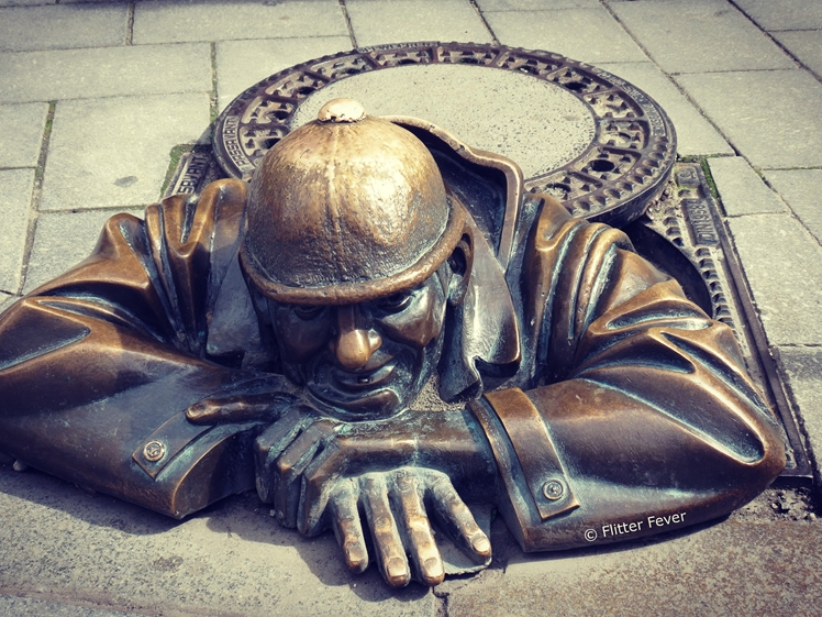 Man at work - Cumil the bronze sewer man statue in Bratislava