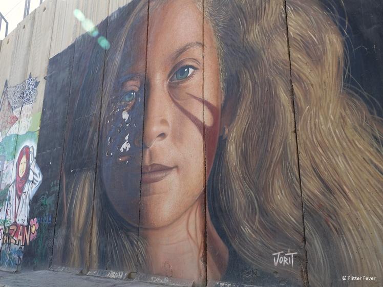 Strong girl by Jorit street art wall Bethlehem