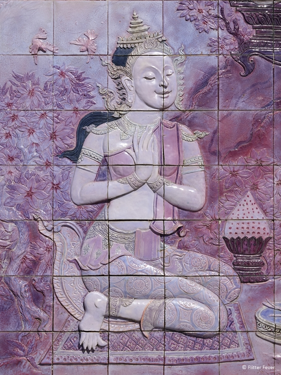 Bhuddist image in purple tiles at Phra Mahathat Naphaholphumisiri in Doi Inthanon National Park