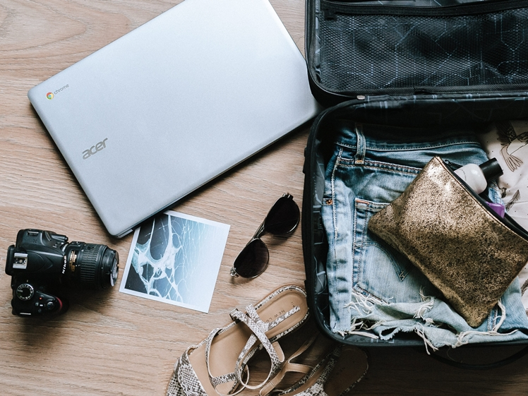 Do you really need to bring that laptop and heavy camera on every trip, travel climate friendlier