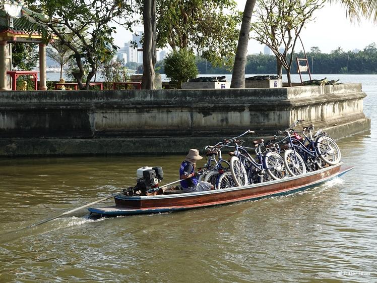 Our bicycles on a boat on the Chao Phraya River towards Bang Kachao Bangkok Thailand