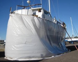 Tenting Southern Wind To Avoid Coating All The Other Boats In The Yard With Sanded Paint