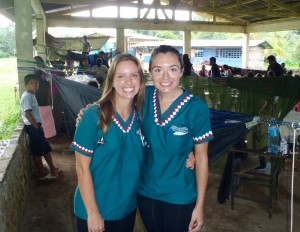 Lauren and fellow UCI med student Christy Tabit showing off their newly decorated scrubs.