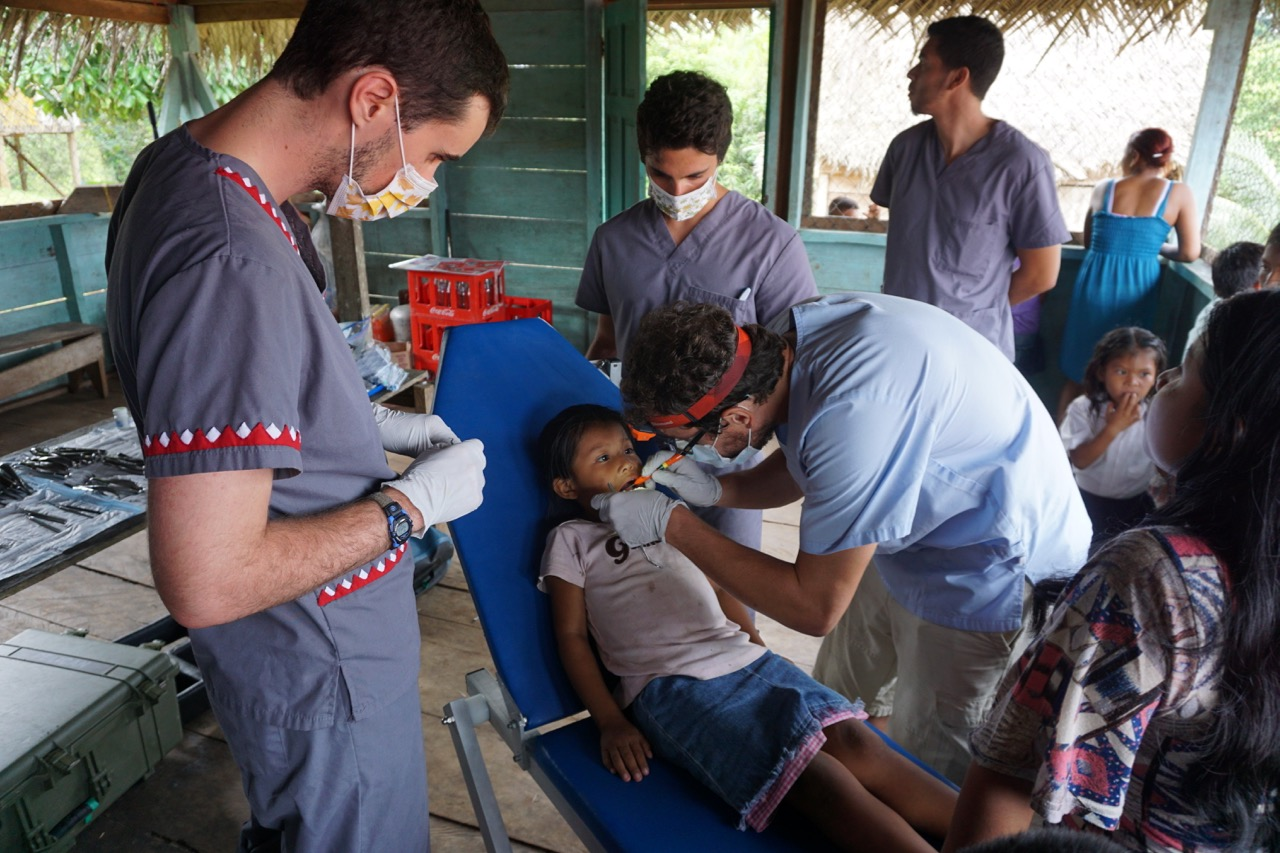Medical Students & Other Volunteers Assigned to the Dental Station to Learn