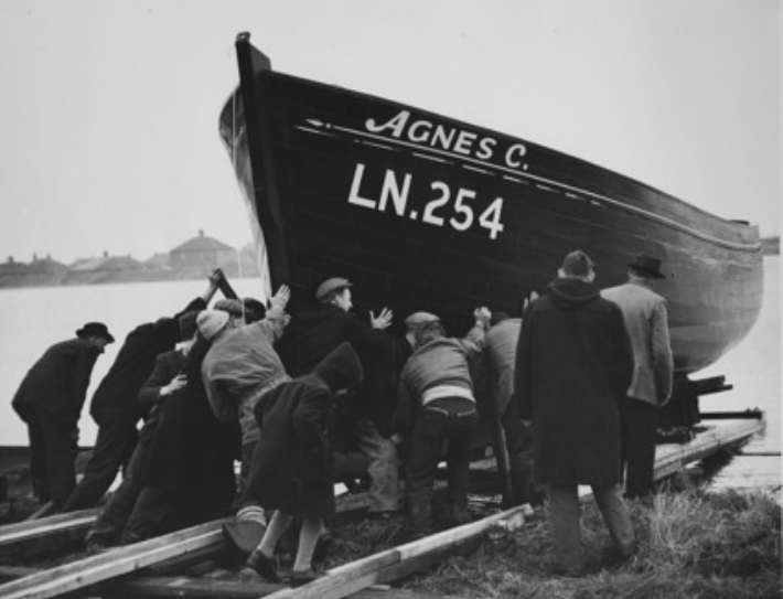 A Worfolk boat being launched
