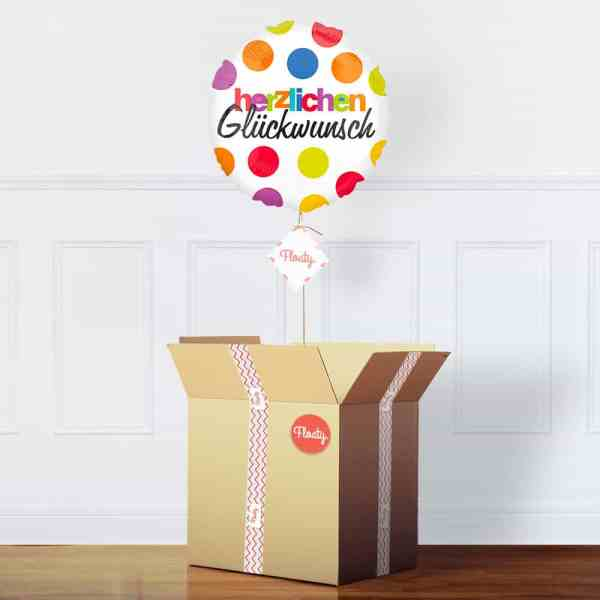 Geburtstagsballon mit Punkten im Karton