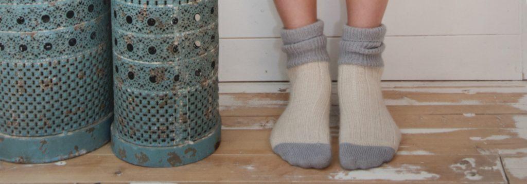 Feet wearing Hazel socks in grey