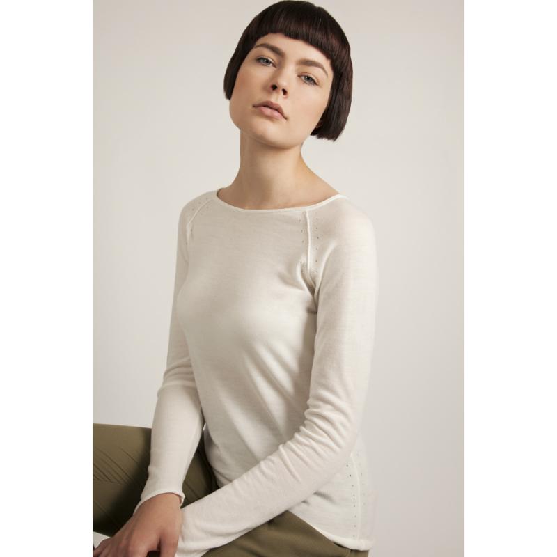 Model wears ivory jumper in merino wool