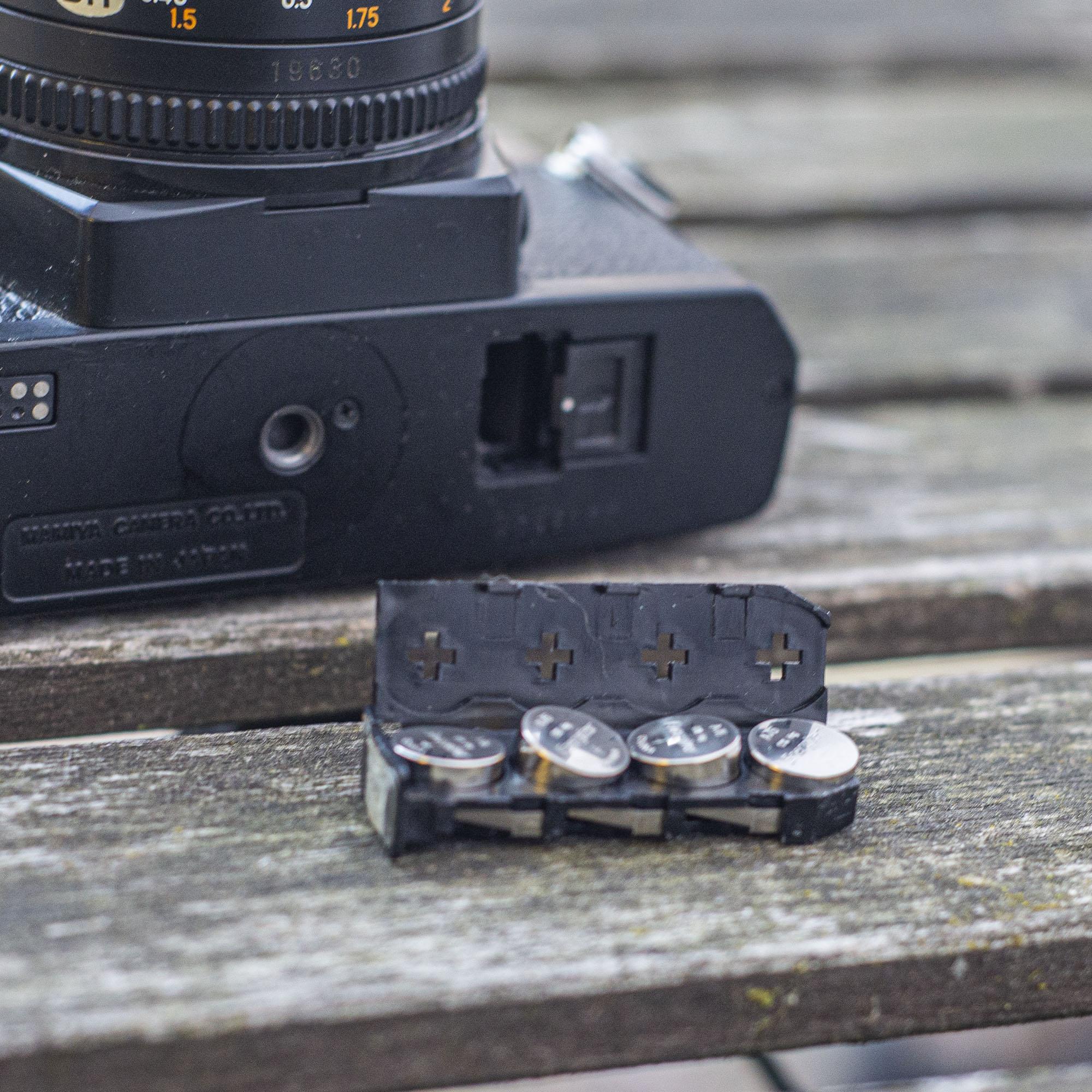 Mamiya ZE-2 battery tray
