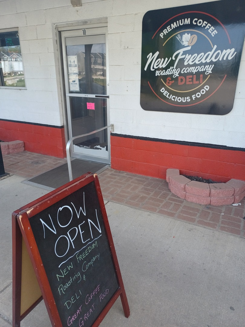 The entrance to New Freedom Deli and Coffee Roasters